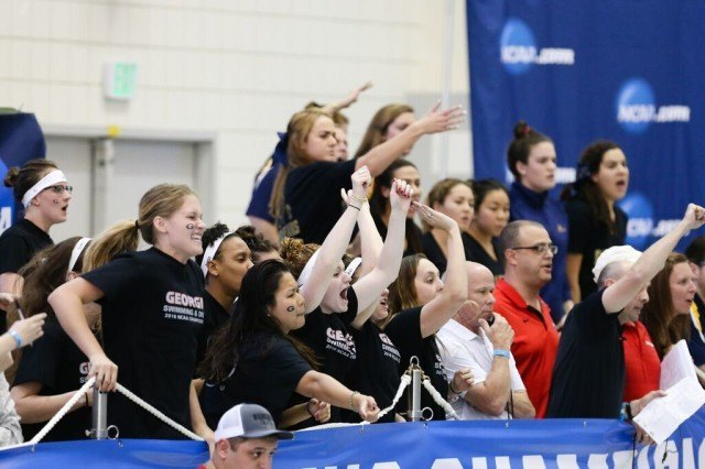 Georgia bench cheering on Day 1 of 2016 NCAA D1 Women's Championships. Photo courtesy of Tim Binning/TheSwimPictures.com