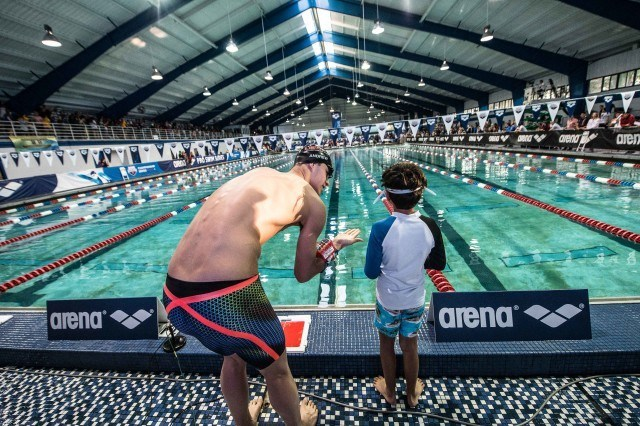 Michael Andrew joins relay with local YMCA swimmers in Orlando (photo: Mike Lewis)