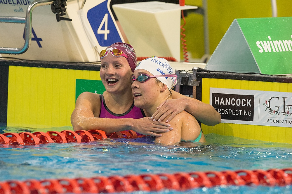 Jessica Ashwood embraces Tamsin Cook after the 400 freestyle (Photo by Steve Christo)