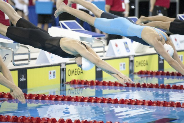 Penny Oleksiak (left) Chantal Vanlandegham (right) 2016 Swimming Canada Olympic Trials.