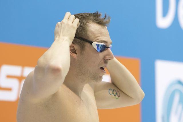 Der Weltmeister hat auf dem Arm das Ziel der Träume eintätowiert: Einmal bei Olmypischen Spielen dabei sein. Da war Marco Koch schon. Jetzt möchte er auf's Podium. Und am besten dazu noch die deutsche Nationalhymne hören.