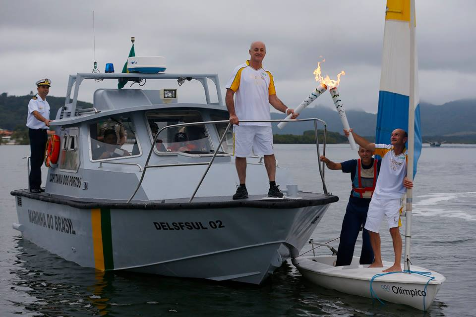 Rio Torch Relay Day 72: Man Attempts To Extinguish Torch In Joinville