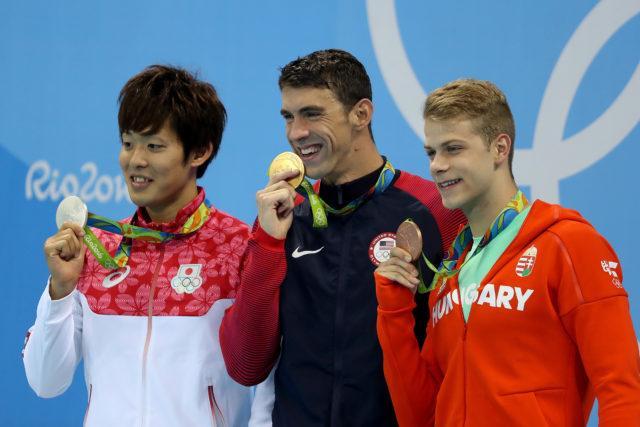 Masato Sakai, Michael Phelps, Tamas Kenderesi - Olympic Podium - gold - 200 fly - 2016 Rio Olympics/photo credit Simone Castrovillari