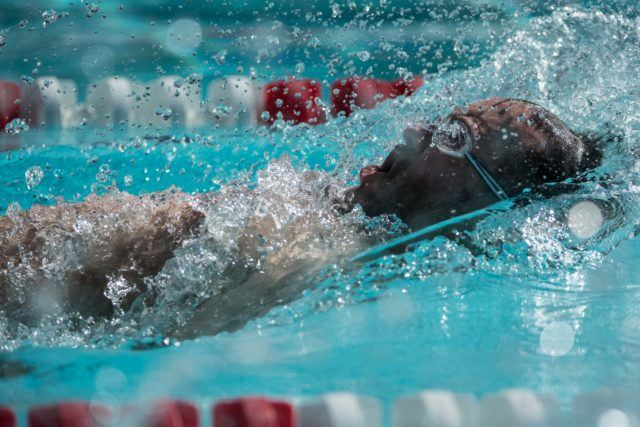 Actor Thornton Cooper (Parks and Recreation) off in the 50 back at the US Masters Nationals in Oregon (Photo: Mike Lewis - Courtesy of U.S. Masters Swimming)