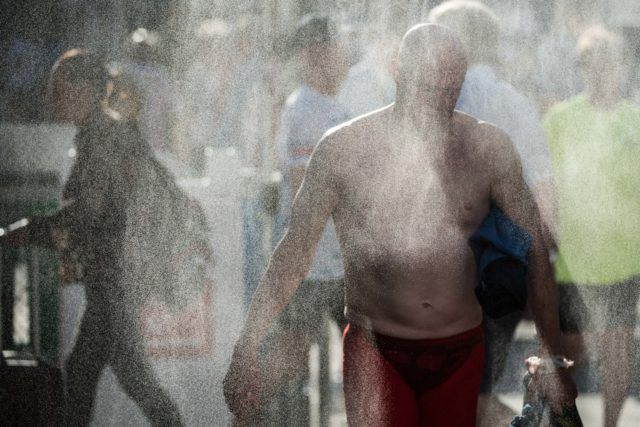 Beating the 100 degree heat with the misters on deck at the 2016 US Masters Swimming National Championship (Photo: Mike Lewis - Courtesy of U.S. Masters Swimming)