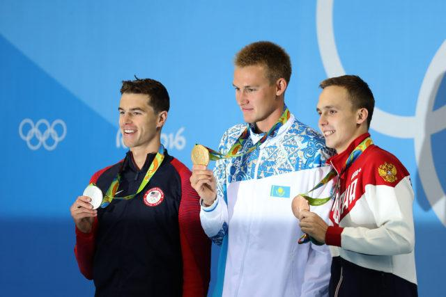 Olympic Podium: Josh Prenot, Dmitriy Balandin, Anton Chupkov - 2016 Rio Olympics/photo credit Simone Castrovillari