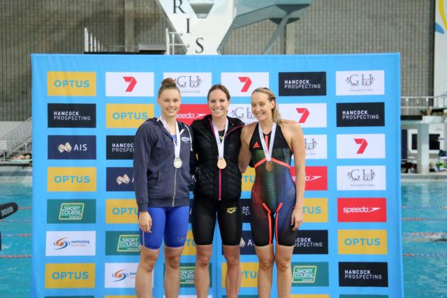 Women's 100m backstroke podium: Emily Seebohm (gold, center), Minna Atherton (silver, left), Madison Wilson (bronze, right); courtesy of Swimming Australia