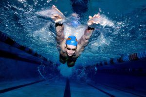 Olympic Champion Swimmer Caeleb Dressel underwater by Mike Lewis