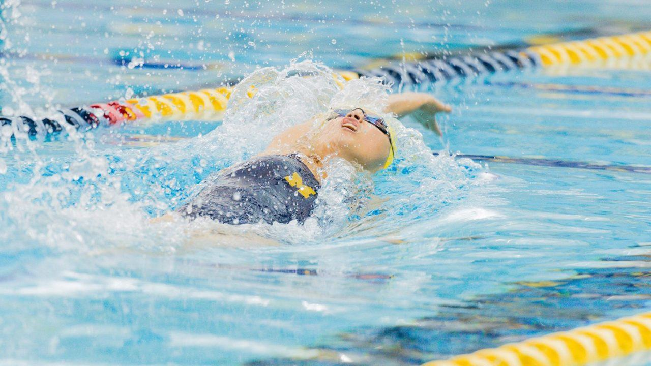 Maggie MacNeil Swims Fast FR/BK Times in Dual Against MSU
