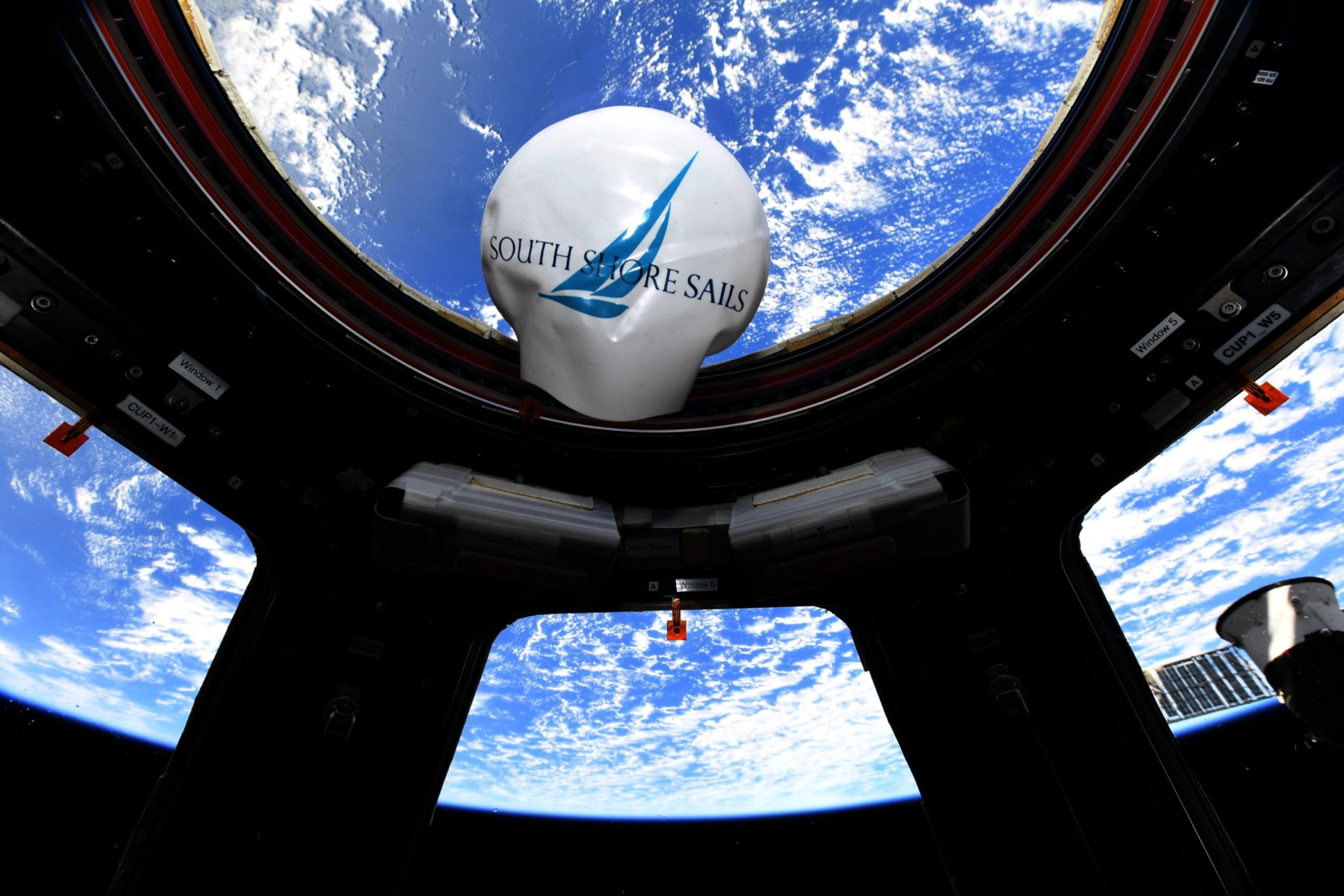 How Did a South Shore Sails Swim Cap Wind Up in Space?